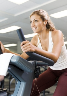 Listening to music while exercising can increase performance, study shows.